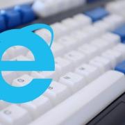 Internet Explorer logo over a computer keyboard