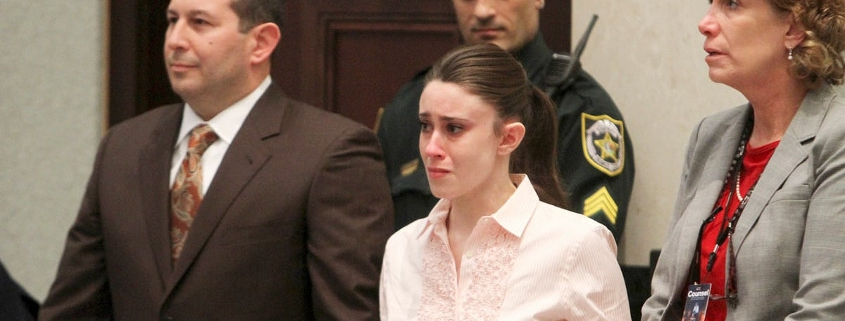 Casey Anthony and Jose Angel Baez standing during the murder trial