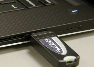 Laptop showing Digital Detective USB dongle