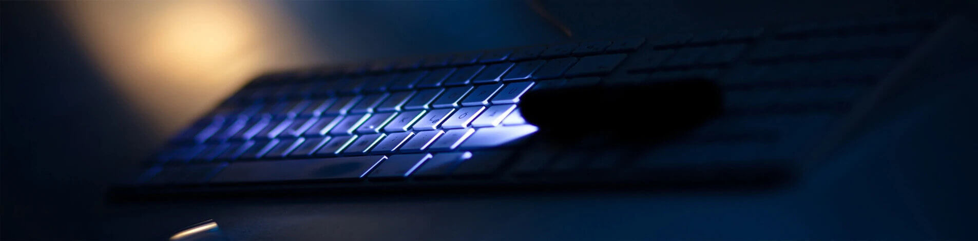 Keyboard being illuminated by a torch